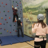 Tackling the climbing wall with some help
